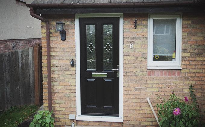 Black composite door with leaded glass