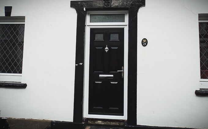 Black composite entrance door installation