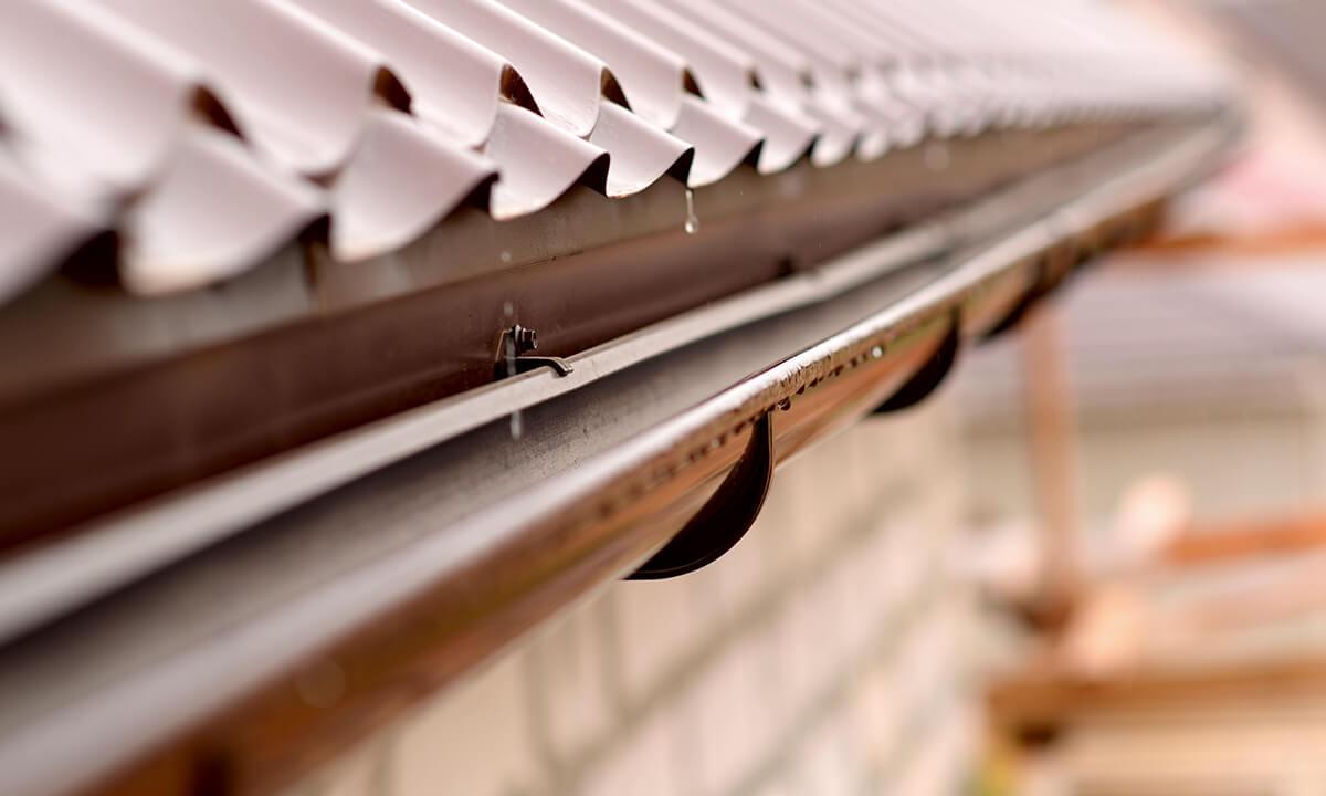 Brown uPVC guttering close up