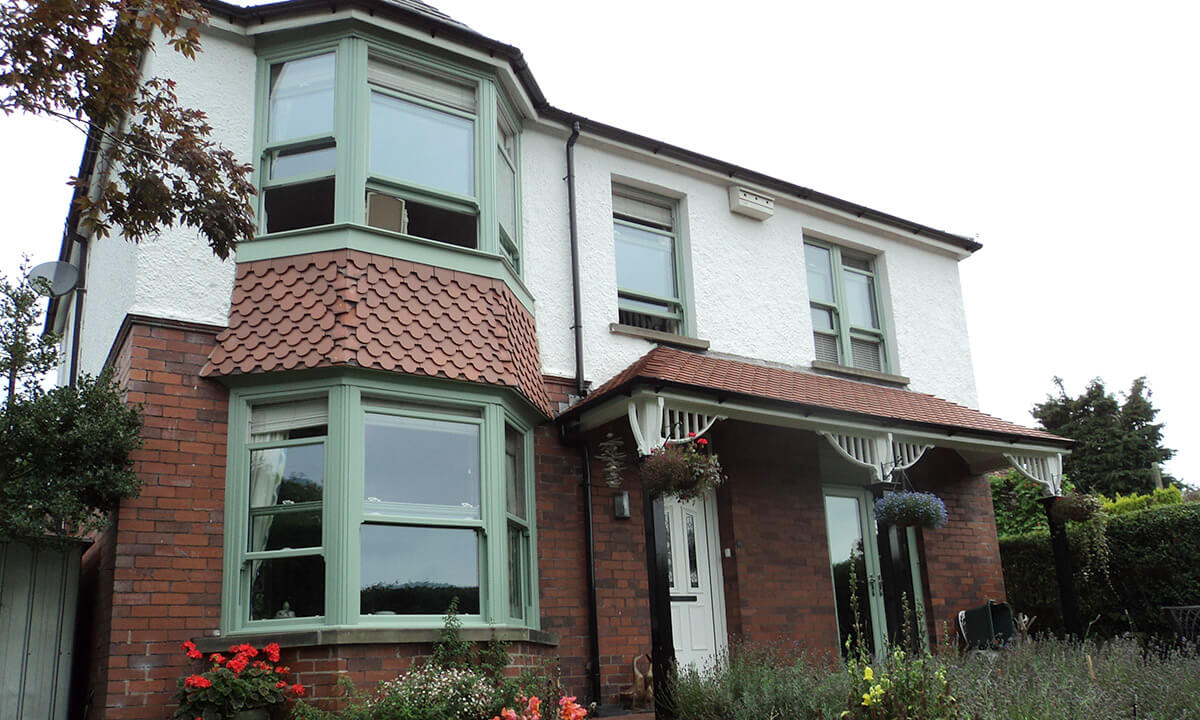 Chartwell green uPVC sliding sash and bow windows