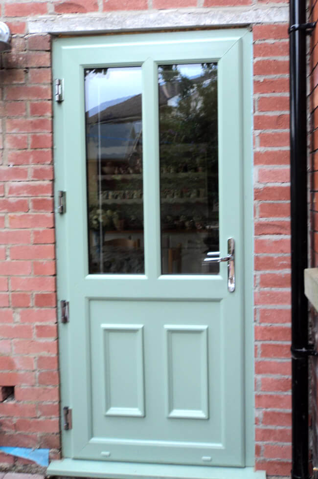 Chartwell green uPVC rear entrance door