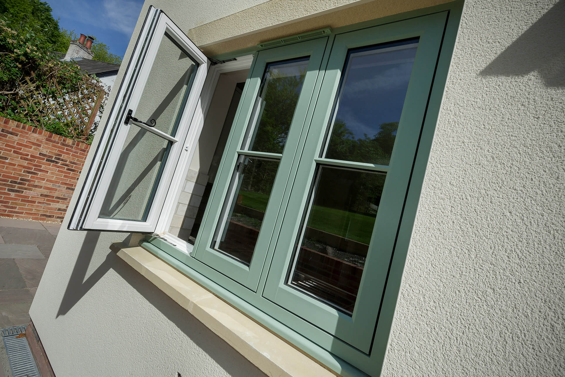 White and chartwell green infinity window