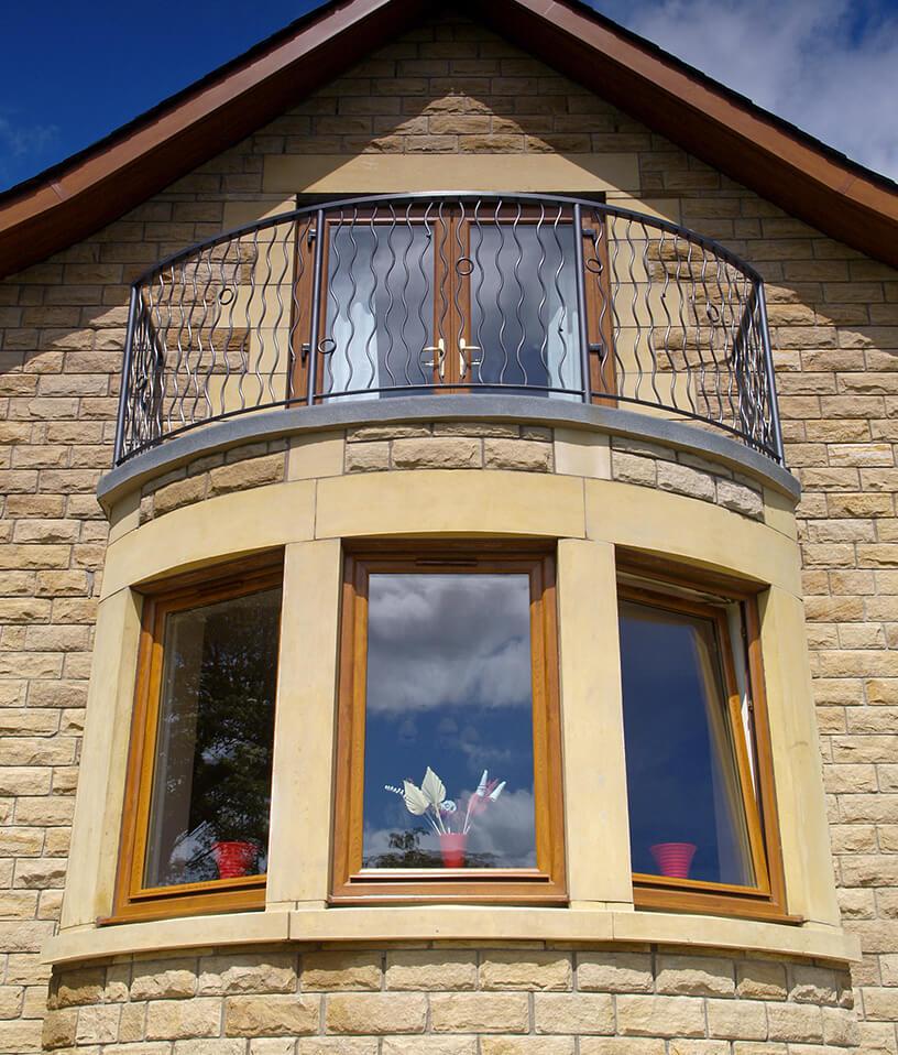 Golden oak uPVC bay windows and door