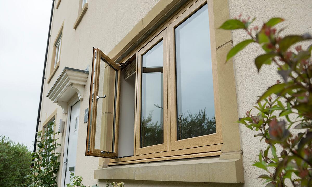 Oak effect flush sash uPVC window