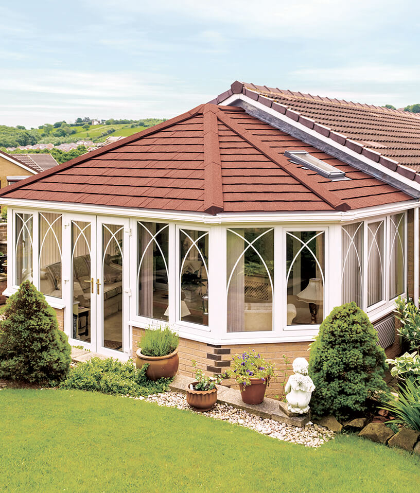 Red tiled roof on a victorian conservatory