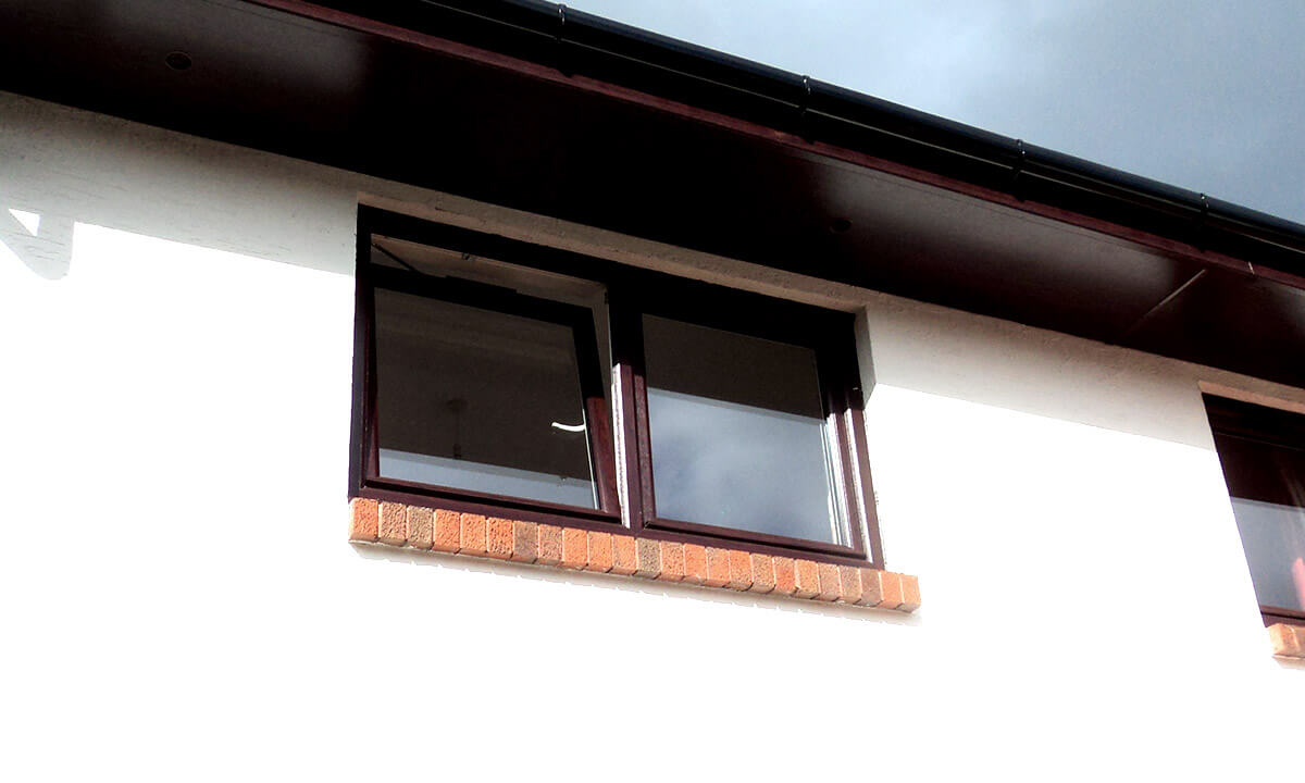 Rosewood effect uPVC tilt and turn window