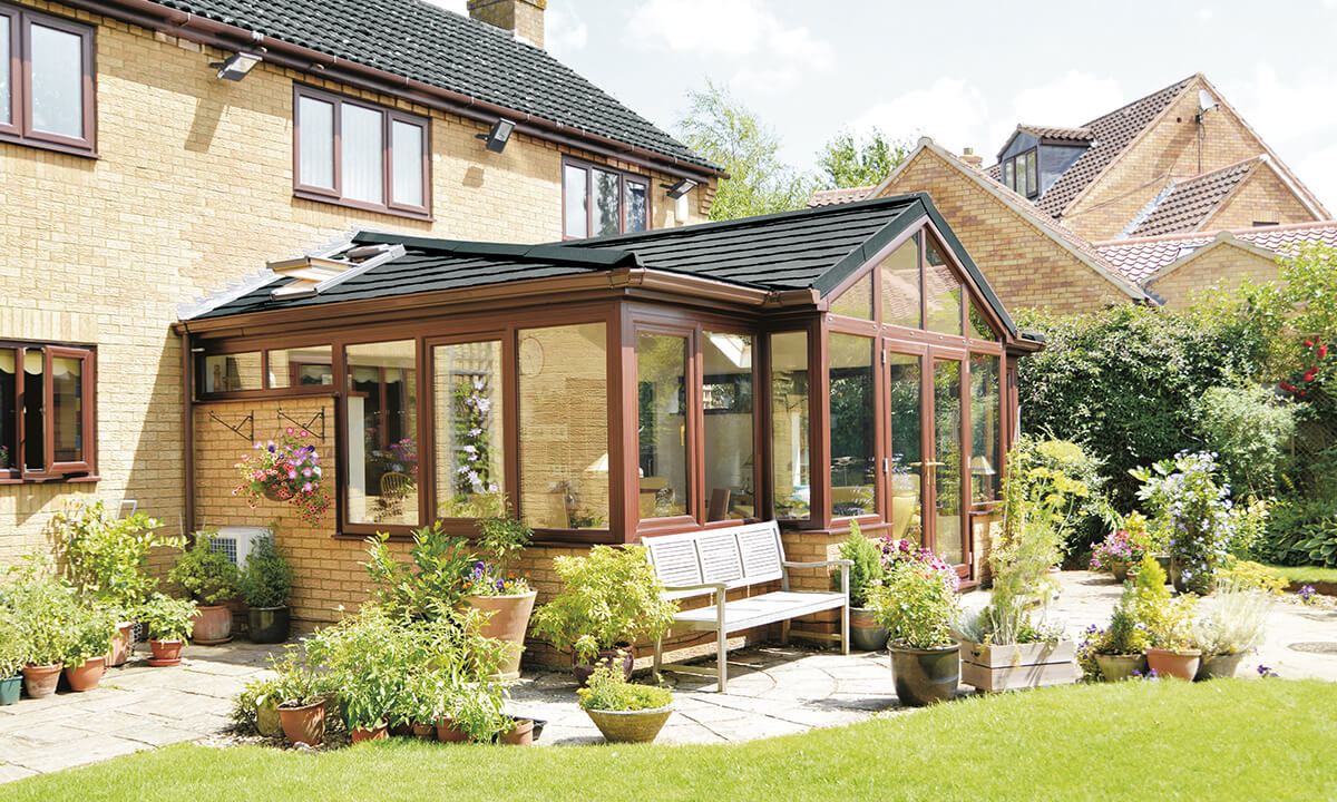 T shaped uPVC conservatory with a tiled roof