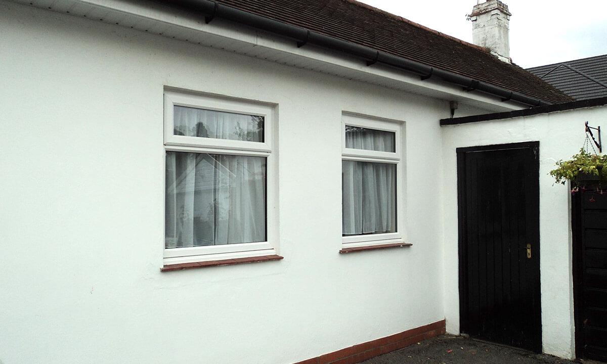 Two white uPVC casement windows
