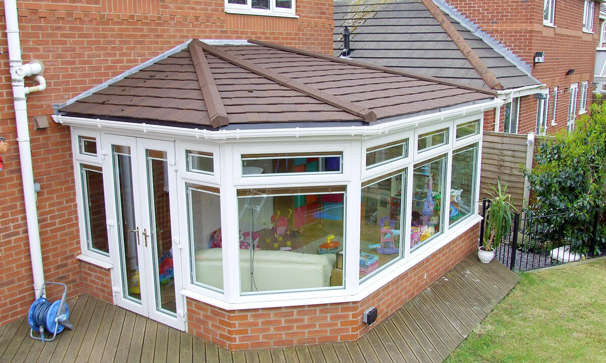 Victorian uPVC conservatory with brown tiled roof