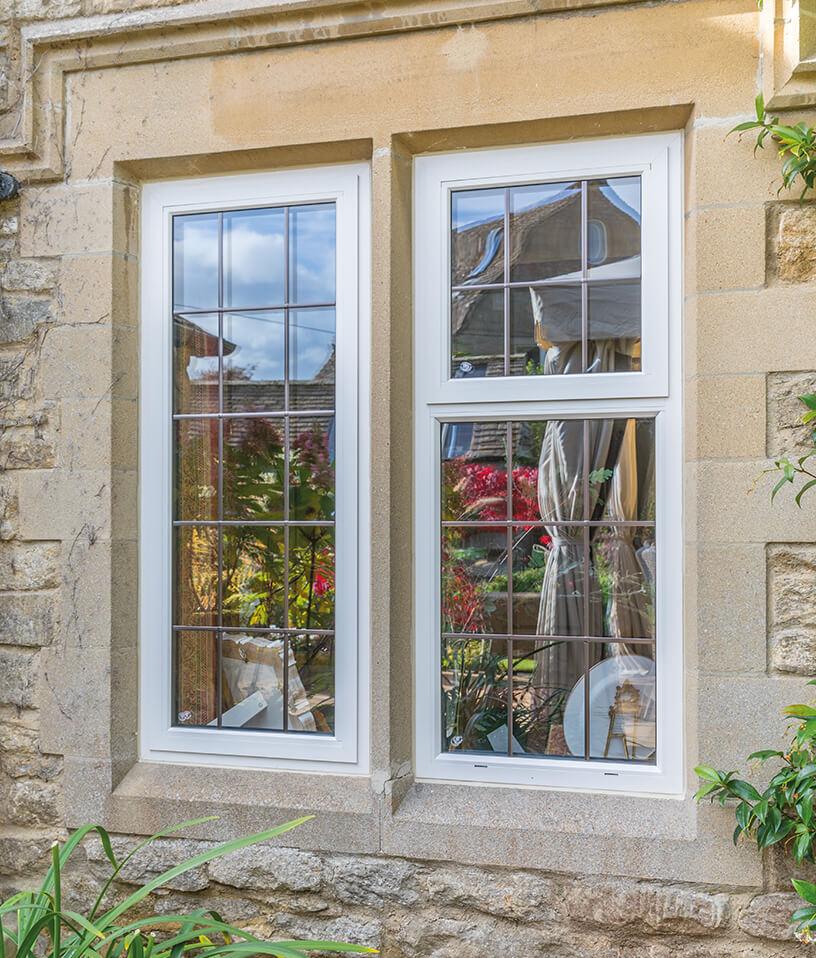 White aluminium casement window installation