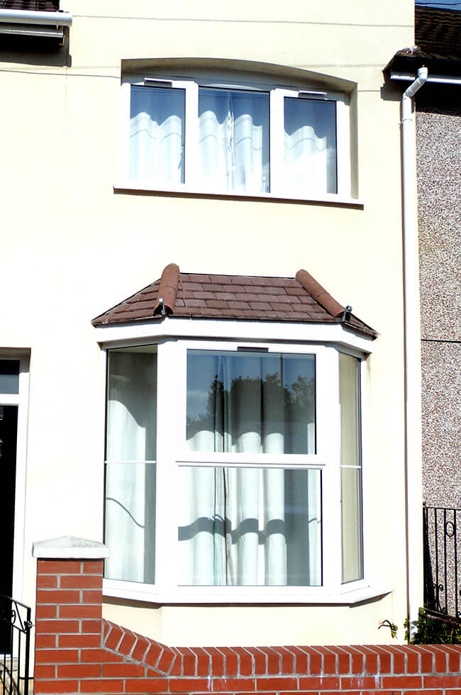 White uPVC casement window and uPVC bow window