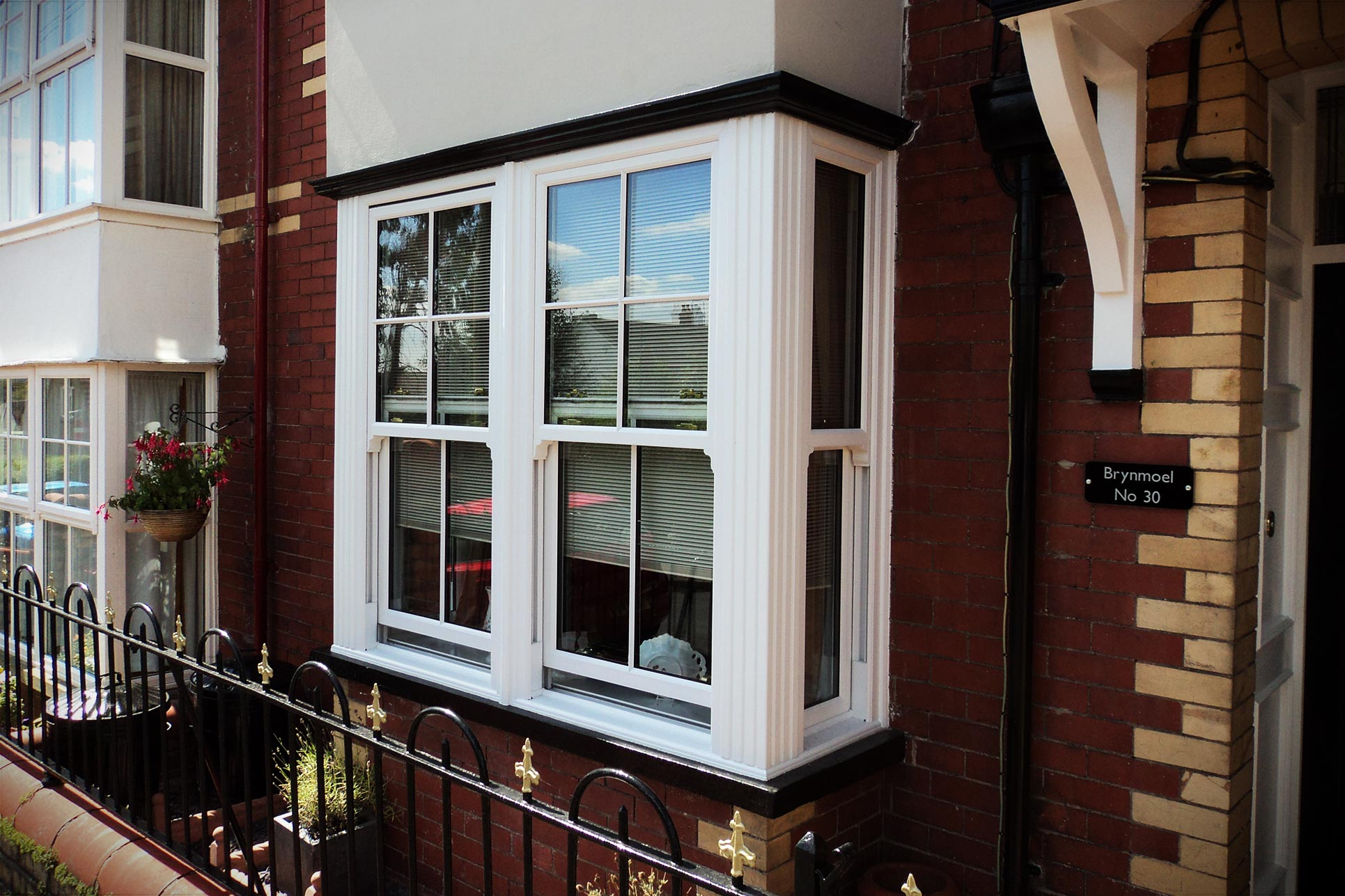 White uPVC bay vertical sliding sash windows