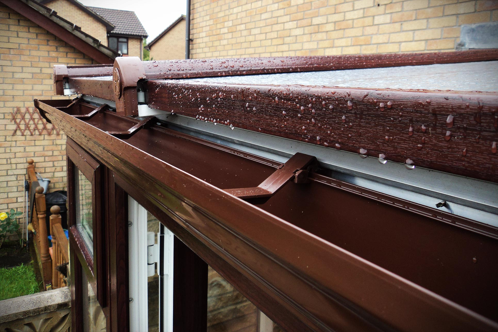 Close up of a brown uPVC conservatory