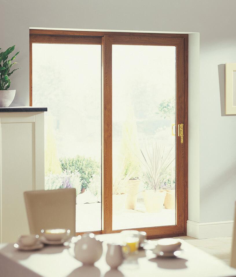 Golden oak effect uPVC sliding patio door