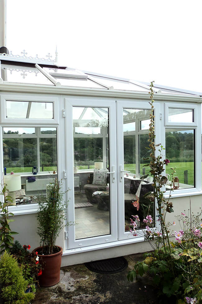 White uPVC conservatory and french door