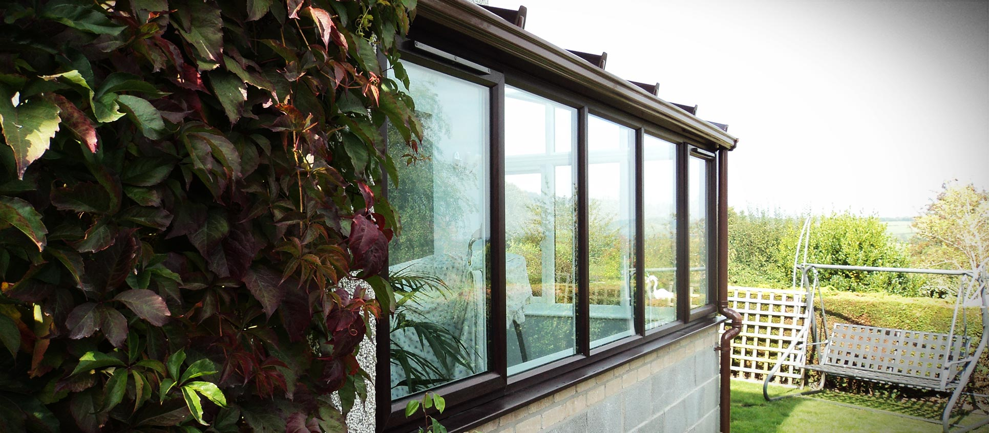 Rosewood lean to uPVC conservatory