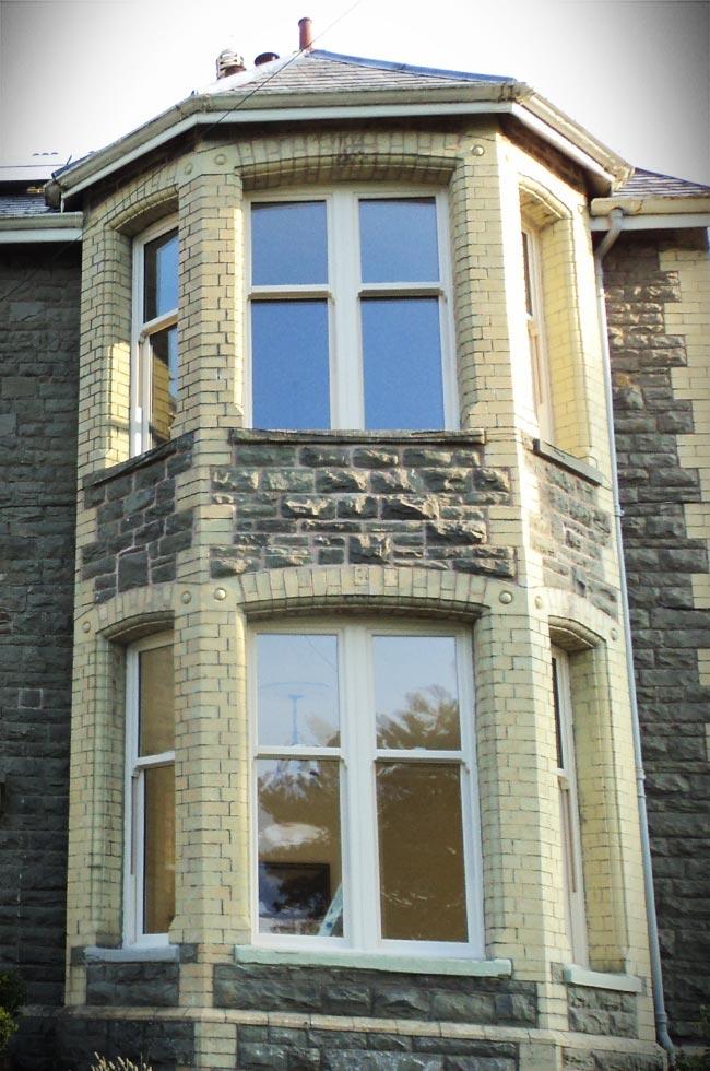 White uPVC bow vertical sliding windows
