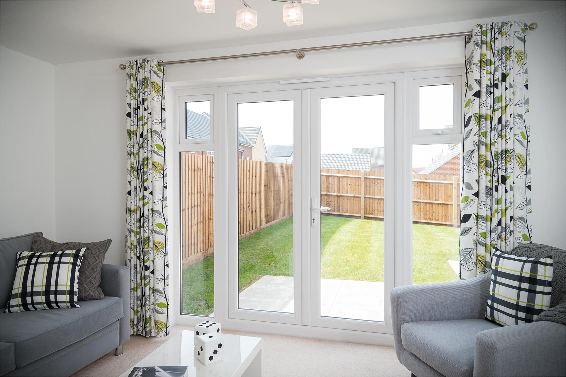 White uPVC french door with side windows
